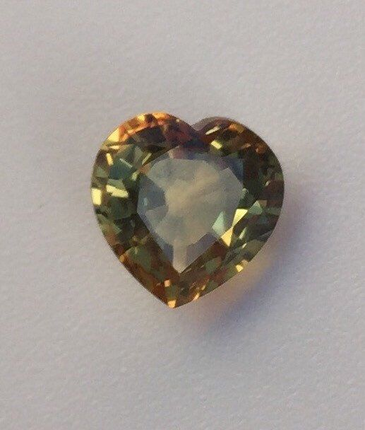 Loose Sapphire stone 2.3 carat, Heart shape Natural Sapphire stone, Loose Heart shape genuine sapphire stone, Bicolor heart shape sapphire by BridalRings on Etsy https://www.etsy.com/listing/273581360/loose-sapphire-stone-23-carat-heart