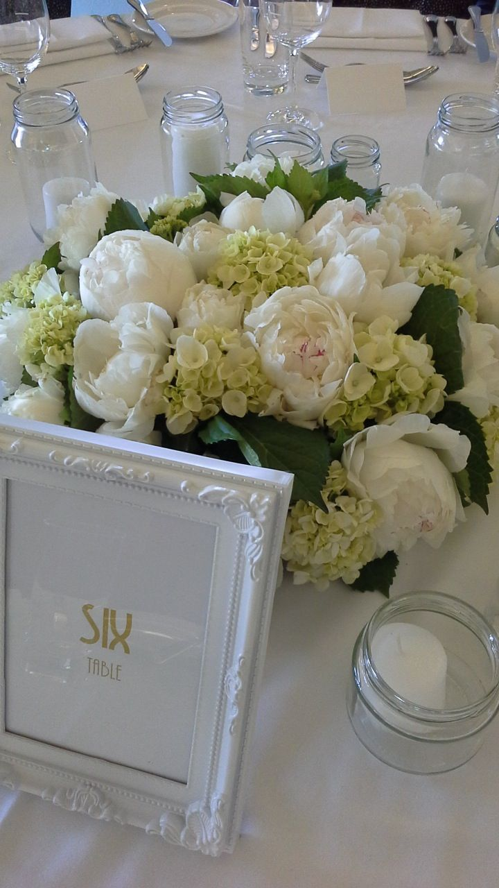 Elegant white flowers and table numbers in white frames to match... #ivyandmoss #eventstyling #whitewedding #flowers #white #wedding #tablenumbers #styling