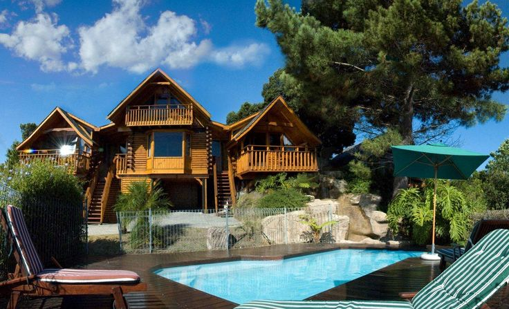 Abalone Lodges is situated on the hill overlooking the Knysna Lagoon and Heads - self-catering log cabins in the heart of the Garden Route