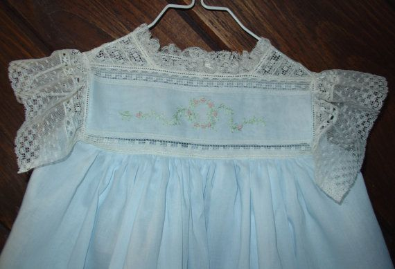 This beautiful little dress is made of imported Swiss batiste nelona and ecru Maline lace. That is why it is so expensive. Maline lace is very