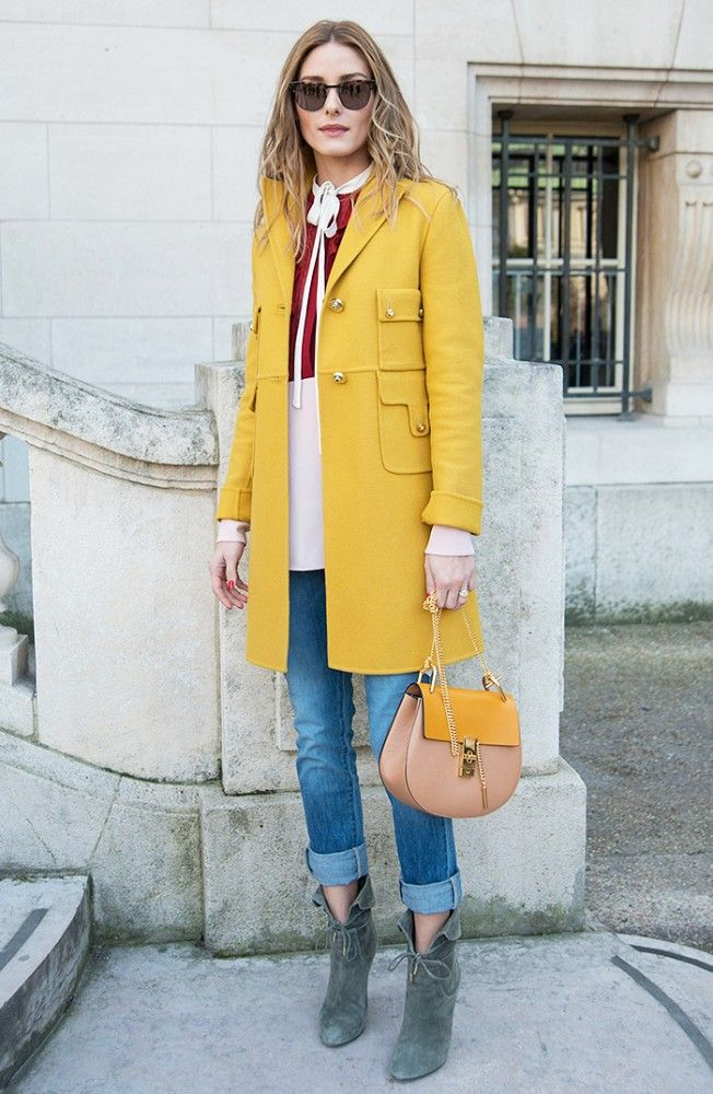 Olivia Palermo pops in a bright yellow coat and green tie-up ankle boots