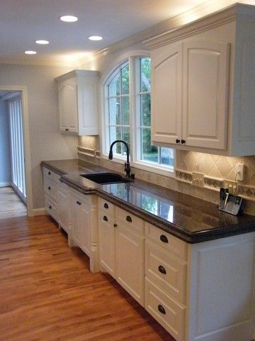 Fresh Light Colored Granite with White Cabinets