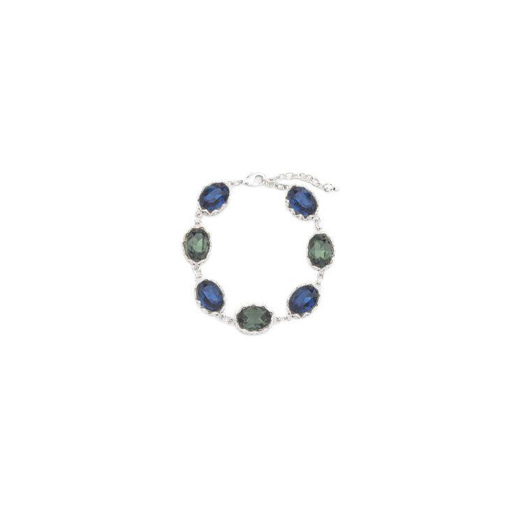 PULSERA JIONI Clase, elegancia y estilo son los atributos de esta preciosa pulsera con delicados cristales en azul y verde engarzados con cadenas bañadas en rodio que te hará sentir como una estrella de cine. Lúcela como complemento del collar con código 316032 o del collar con código 316034. Largo 18cm.