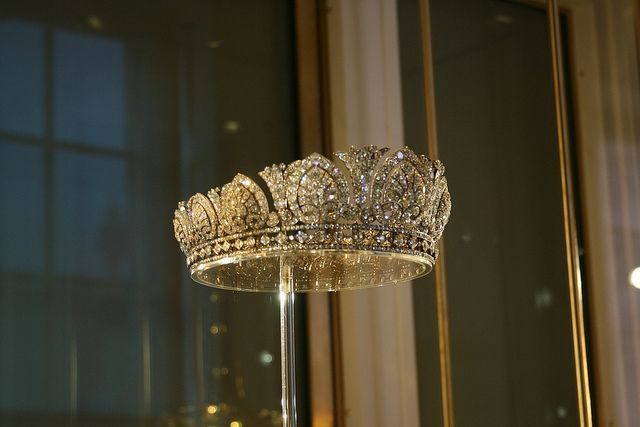 The Devonshire Tiara, circa 1893-1897,  English: diamonds mounted in silver and gold. This tiara was made for the wife of the 8th Duke of Devonshire, Countess Louise von Alten. She was known as the 'Double Duchess' as she had previously been married to the Duke of Manchester. The tiara is designed as a graduated row of thirteen scrolled palmette motifs, alternating with lotus motifs. These can be removed and worn as individual brooches and other ornaments.