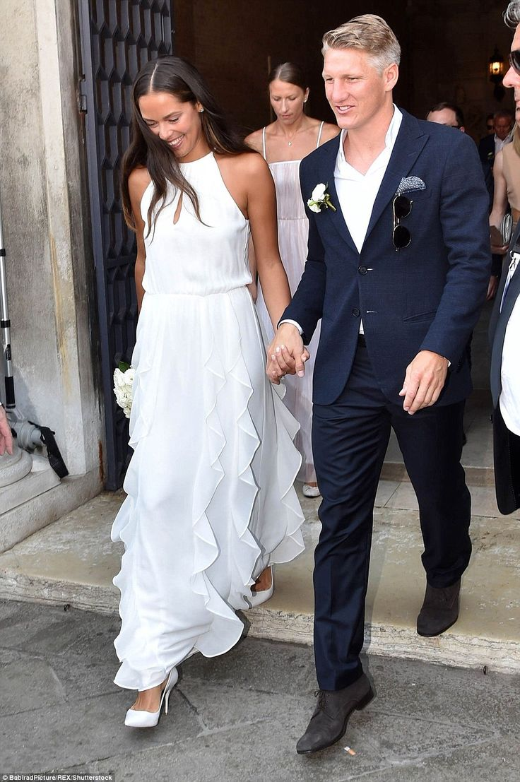 White wedding:The halter-neck style emphasised her toned arms, while a keyhole split deta...