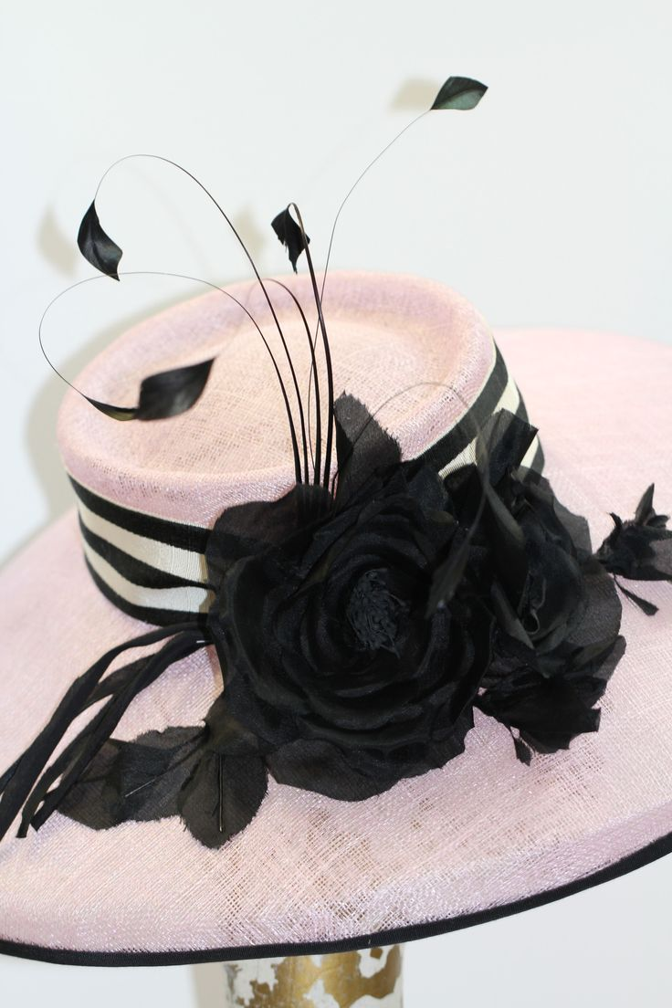 Kentucky Derby Hat, Wide Brim Hat, handmade hat This handmade hat is sculpted from sinamay yardage. It is adorned with a cluster of silk roses in black, vintage striped petersham ribbon and feathers.