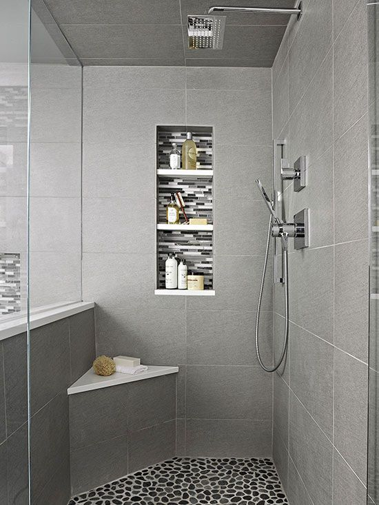 A small bench takes advantage of the angled corner of the shower, and a tall niche with 3 shelves provides plenty of in-shower storage.