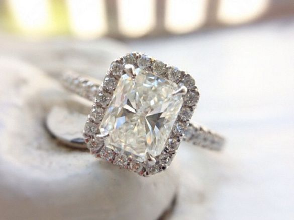 Slightly elongated radiant diamond with a diamond halo, and diamonds on the band.  #CustomEngagementRing #RadiantRing #RadiantDiamondWithHalo #RadiantHaloRing #UniqueEngagementRing #TAnthonyJewelers