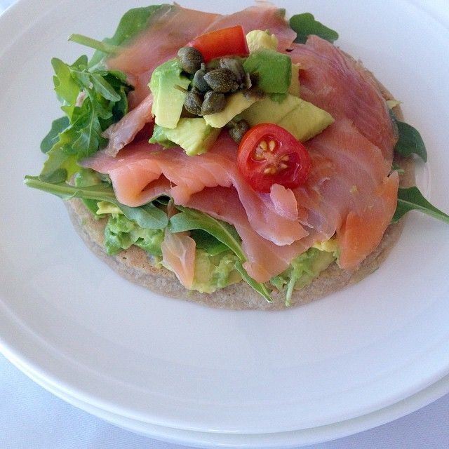 Smoked salmon on crepe and a bed of avocado and rocket. Topped with cherry tomatoes and capers.