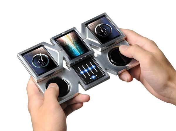 Grand Wizard - DJ Smartphone by Yu Hiraoka: turns the user into a real life mixmaster DJ with turntables and everything! Wonder what the full specs are and if it's any use as a smartphone generally as well.