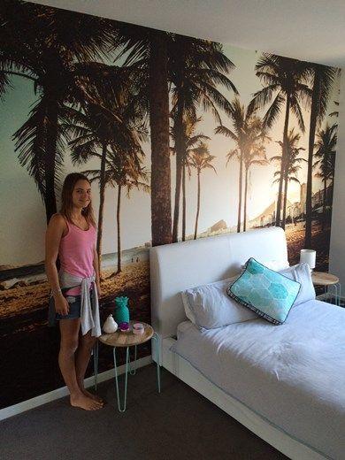Ella showing off her wall mural of Ipanema Beach in Rio de Janeiro!