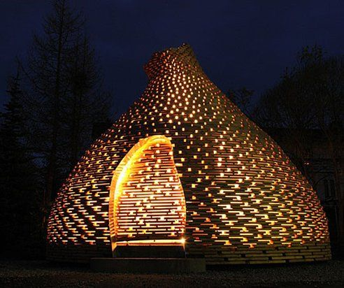 A fireplace dome by Norwegian firm Haugen/Zohar Arkitekter is located in a…