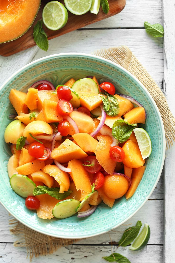 A summery 10-ingredient melon salad with cantaloupe and mint tossed in lime juice, paired with cucumber, tomatoes and onion tossed in a light vinaigrette.