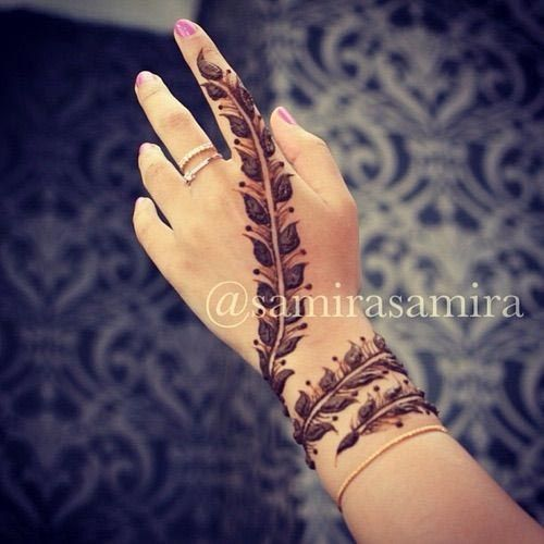 Wrap around wrist feather henna design