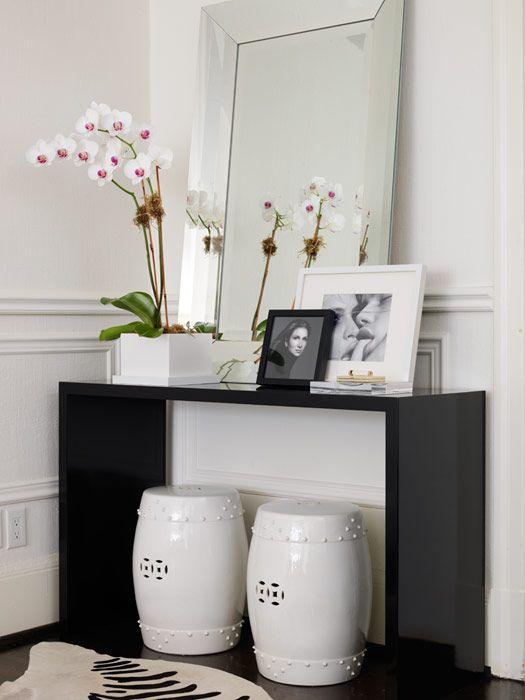 Ferreira Design - entrances/foyers - White Ceramic Garden Stools, Zebra Cowhide Rug, Mirrored Edged Mirror, glossy, black, modern, console, table, beveled, mirror,