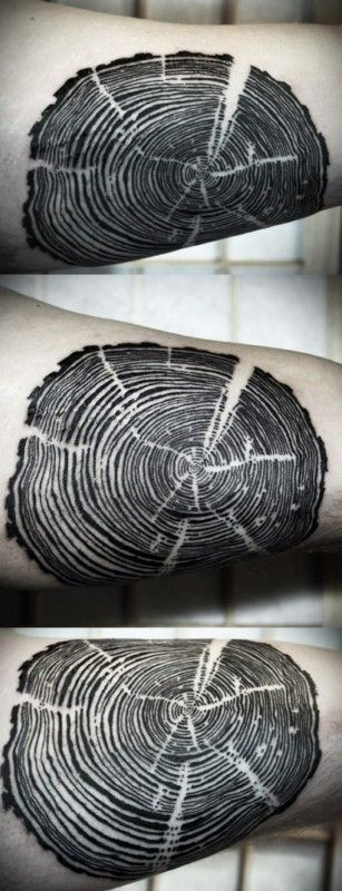 Cool black tree rings tattoo by David Hale
