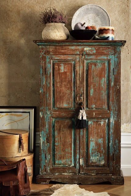 turquoise touches on wooden cabinet