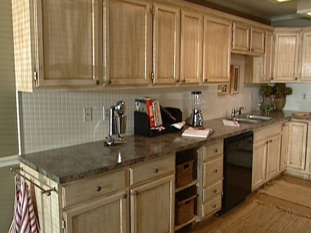 How-to video- how to glaze kitchen cabinets. I wouldn't start out with white, i would still do off-white. Then focus the dark glaze in the low areas.