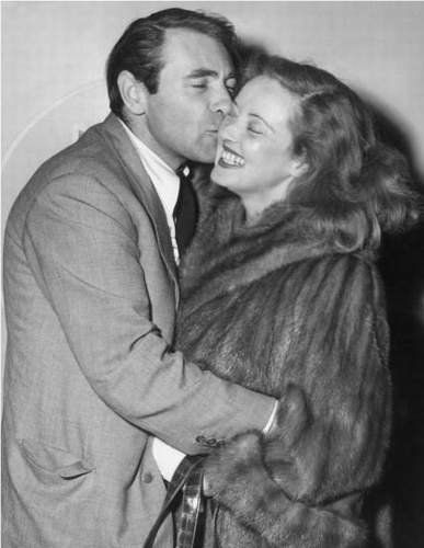 Bette Davis greeted by her favorite husband Gary Merrill.