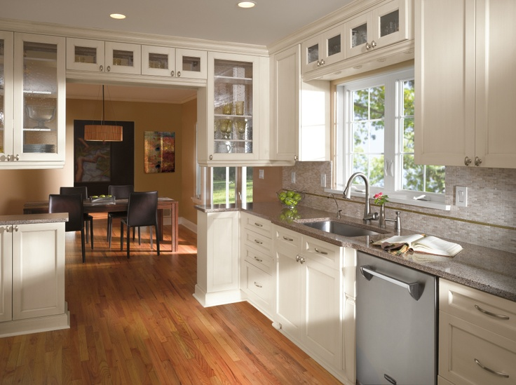 Kitchen Craft's simplistic design with  white Millstone Weathered Slate finish against light oak floors creates a light, casual atmosphere in any chaotic kitchen. http://www.kitchencraft.com/