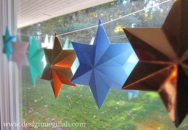 Six-pointed paper stars make a sweet garland (and a fun folding activity with the kids). #chrismukkah