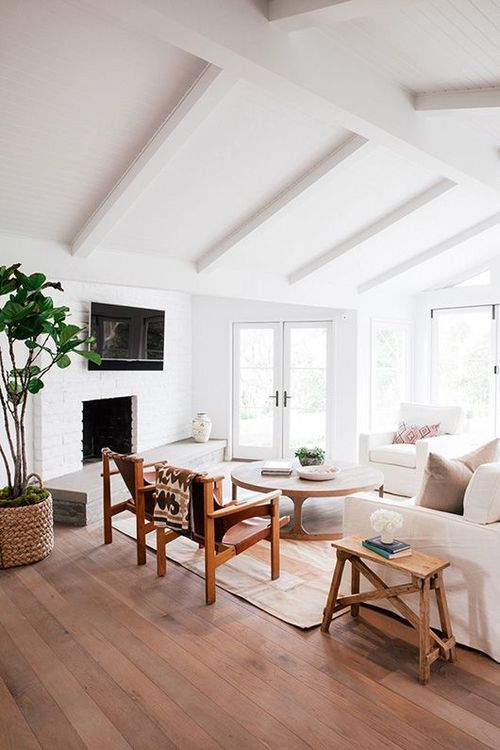 Timber, leather and white, white, white always a beautiful combination. Just a tiny pop of natures green.