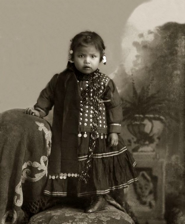 Ho-Chunk Girl in Hiiwapox Blouse. Photo: ca. 1895. - The Ho-Chunk, also known as Winnebago, are a Siouan-speaking tribe of Native Americans, native to the present-day states of Wisconsin, Minnesota, and parts of Iowa and Illinois. Today the two federally recognized Ho-Chunk tribes, the Ho-Chunk Nation of Wisconsin and Winnebago Tribe of Nebraska, have territory primarily within the states included in their names.