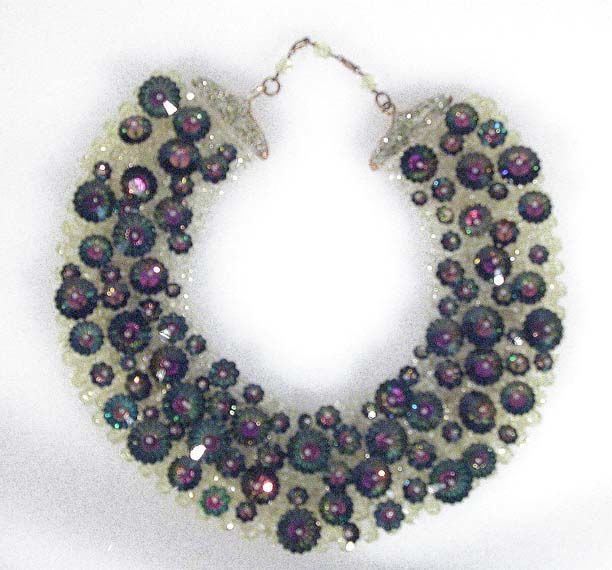 Coppola e Toppo Lime and Iridescent Collar Italian, 1960s The base of multifaceted plastic beads hand mounted with floriform faceted and pinned green to mauve rhinestones, 2 1/2 x 16 inches, marked: Made in Italy/Coppola e Toppo. Very good condition, one pin fragile.  Sold for $1,560 (2005)