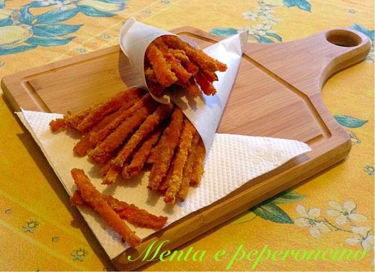 """La """"Ricetta bastoncini di carote con impanatura croccante"""" è un ottimo finger food leggero e gustoso,servitelo con un buon aperitivo,vi piacerà sicuramente."""