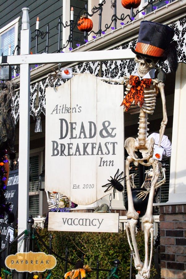 ideas for diy halloween decor outdoor sign post with skeleton in a top hat use near front door or porch