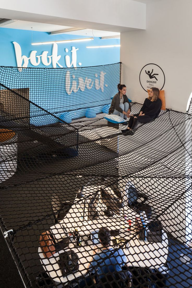 A large net for lounging around in is a significant feature of the new Lisbon headquarters for Uniplaces office.