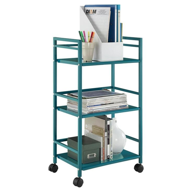 From the living room to the bathroom to the kitchen and beyond, the Ameriwood Home Marshall 3 Shelf Metal Rolling Utility Cart is a great addition to your home. Featuring a minimalistic style, the cart has 3 large shelves. Each shelf has 3 wraparound bars and can hold up to 20 lbs. Easily roll the cart from room to room on the 4 casters, 2 of which lock into place. Thanks to the teal powder-coated metal finish, it will look great with any color scheme. Assembly is required, and the final…