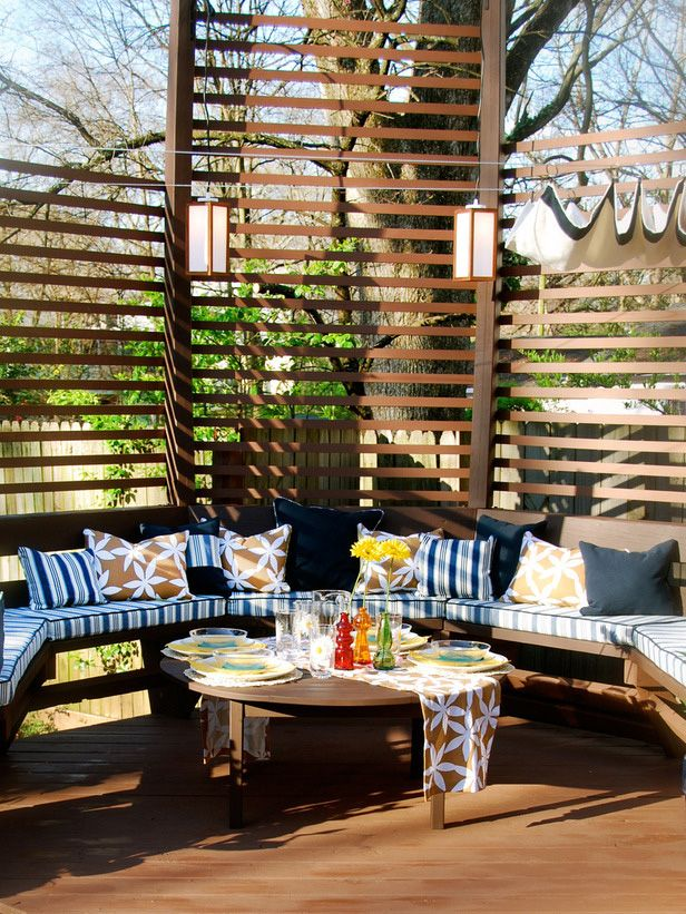 Make sure guests at outdoor parties have a place to get cozy and relax, including options in the shade.
