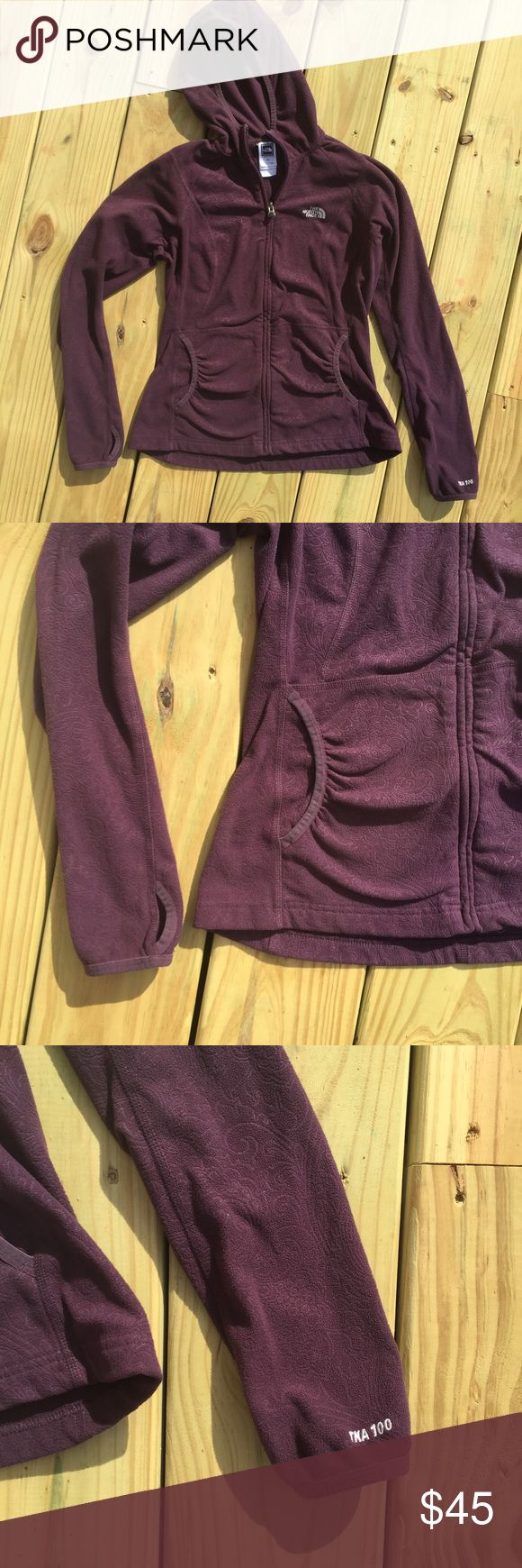 THE NORTH FACE 🐢 purple fleece zip up cute jacket The perfect 👌🏼 shade of aubergine - this is a warm and comfortable womens ladies authentic The North Face full zip fleece jacket sweater pullover hoody. Jacket features two pockets, flattering shirred sides, thumb holes, a hood , and subtle soft brocade paisley pattern throughout. Sized small, this gently preloved 🎀 hoodie is in great condition! The North Face Jackets & Coats Utility Jackets