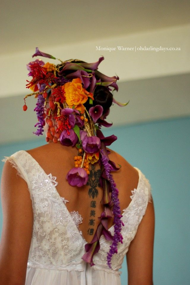 The Edgy & Inked Bride - The amazing floral headpiece, made by Heike ofFleur Le Cordeur, ran down the models back alongside hertattoo. Using metallic gold thread, tulips, orchids and berries were woven into a a colourful and utterlyexquisiteheadpiece.