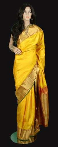 Mustard Kanjeevaram saree with elephant motif gold border with buttas