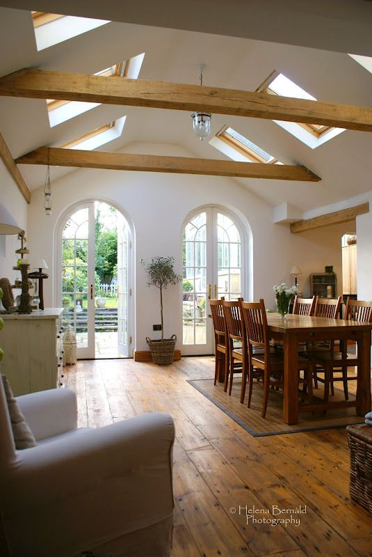 love the skylight windows with the beams.....and how about those french doors!!!!!