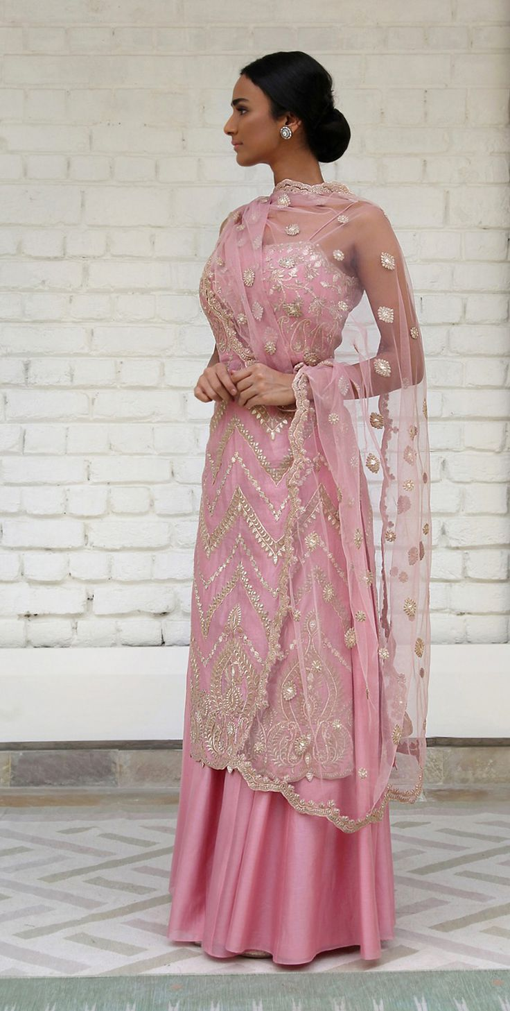 Rimple and Harpreet Narula. Blush pink Chanderi silk straight shirt with all over gotta-tilla embroidery; paired with a soft tulle dupatta and silk sharara.