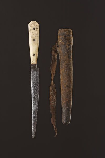 A Slender Ivory and Steel Single Edged English Knife and Sewn Leather Shealth    15th-16th Century    25.5cm long – 10 ins long