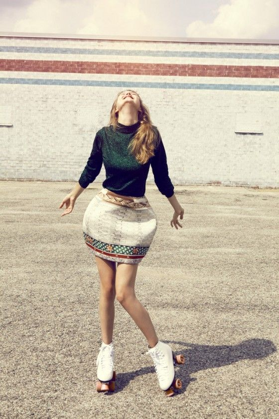 Lindsey Wixson for Oyster Mag. Smiling model with roller skates, old school looking shot with aged color pallet.