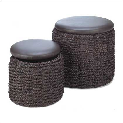 """UPC: #13824 Add the finishing touch to your décor with these designer ottomans with bonus secret storage! Beneath the plush padded lids of these handsome woven grass foot stools, plenty of unsightly clutter hides neatly out of view. Weight 16.7 lbs. Rush grass, fabric lining, wood, and faux leather. Large: 18"""" diameter x 16"""" high; small: 14"""" diameter x 12"""" high. Set of 2. $75 (plus tax/shipping). - to place an order for this product, contact us at asimpletouchgallery@gmail.com"""
