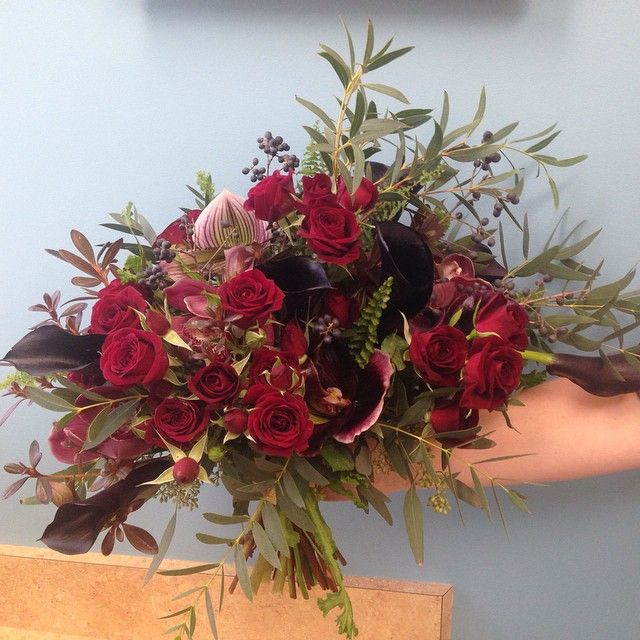 Deep reds, purples and black flowers for this dark bridal bouquet.