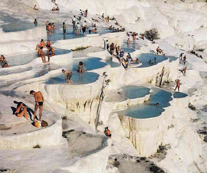 Pamukkale (Turkey) is an ethereal destination, with a name that translates into English as 'Cotton Castles'. The landmark is a naturally occurring phenomenon of white stalactites and water-filled plateaus. The geothermal hot springs frequented by tourists are full of naturally occurring minerals.