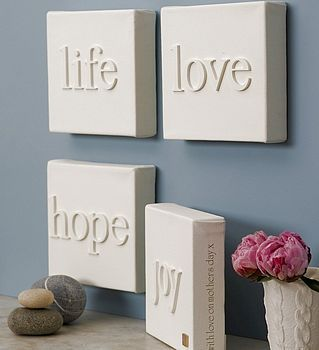 Canvas + wood letters, then paint the whole thing. White on white....and I totally have everything to make these.
