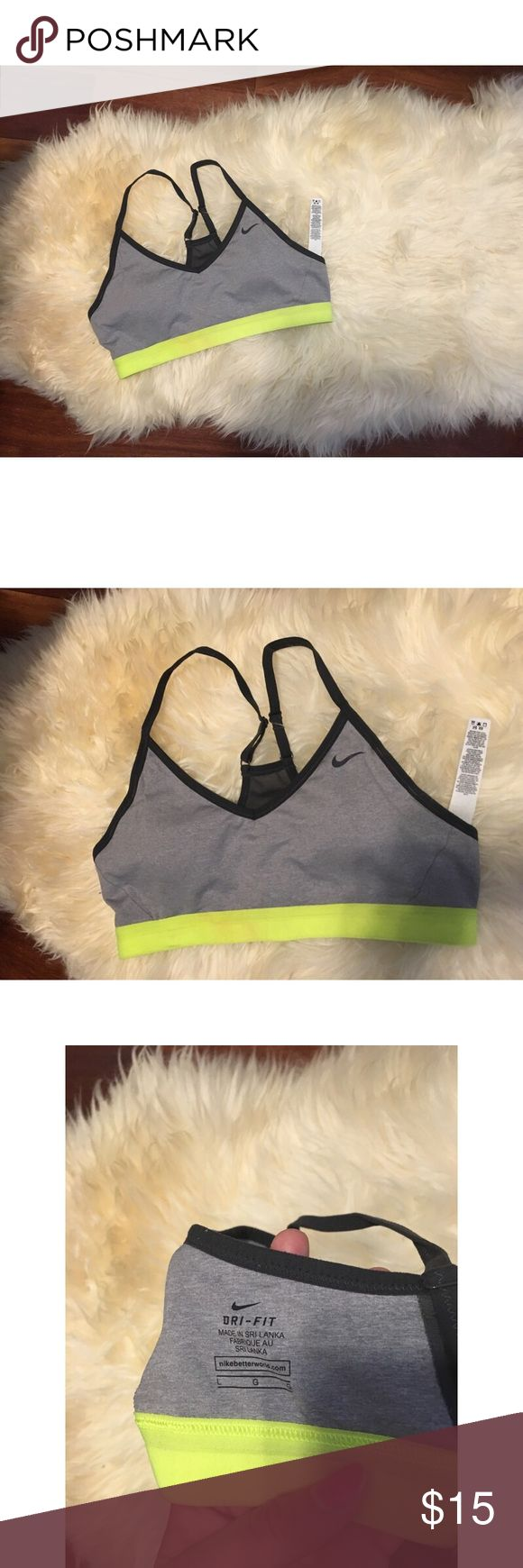 Nike Neon and Grey Sports Bra 💕 this is a lightly loved neon and gray Sports Bra from the brand Nike. No signs of wear. Worn once thinking I was going to work out 💕 Nike Intimates & Sleepwear Bras