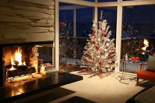 Love the open fireplace with large harth and the floor to ceiling windows! If we ever get to build our dreamhouse.....