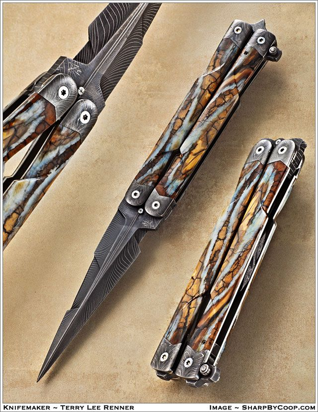 Balisong by Terry Lee Renner.  Multi-plane blade grind. Dual-directional dovetailed, long-cut handles and bolsters. Ball-bearing pivots. Split latch encloses the blade tip when closed, serves as skull-point when open. Carved mammoth tooth handle slabs, spine pieces. Form-fit carved bi-directional sheath with viewing cutouts.