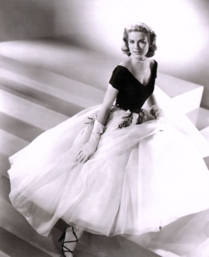 """The stunningly beautiful Grace Kelly.  Look at that dress!  This is from Hitchcock's """"Rear Window."""""""