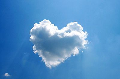 Here's a photograph taken of a solitary cloud in a heart formation Photo by lennysan