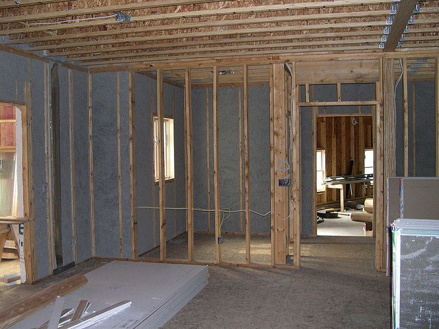 Spray cellulose insulation. Cellulose has the highest recycled content of any insulation material (mainly newspaper and cardboard) and also has less embodied energy than fiberglass and other furnace produced mineral insulation. Photo by labelle253, via Flickr.
